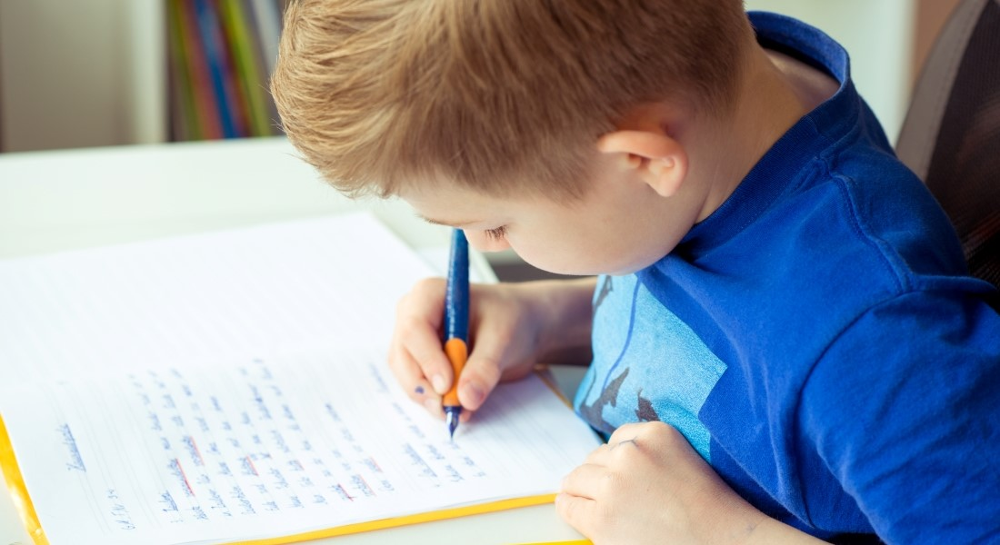 Boy writing - Colourbox
